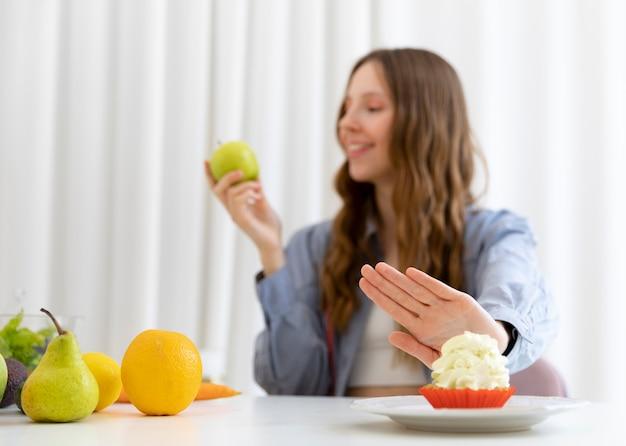 Medium shot woman holding apple
