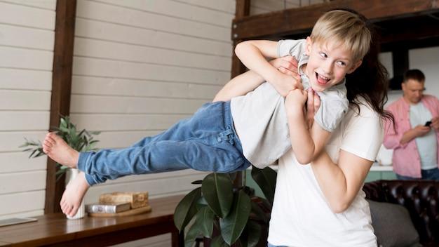 Medium shot woman holding boy