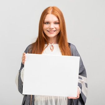 Medium shot woman holding canvas