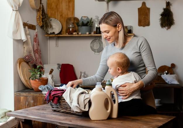 Medium shot woman holding child