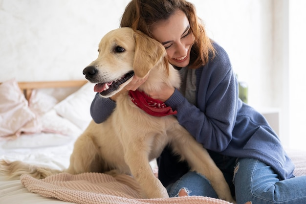 Medium shot woman holding dog