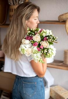 Medium shot woman holding flowers bouquet