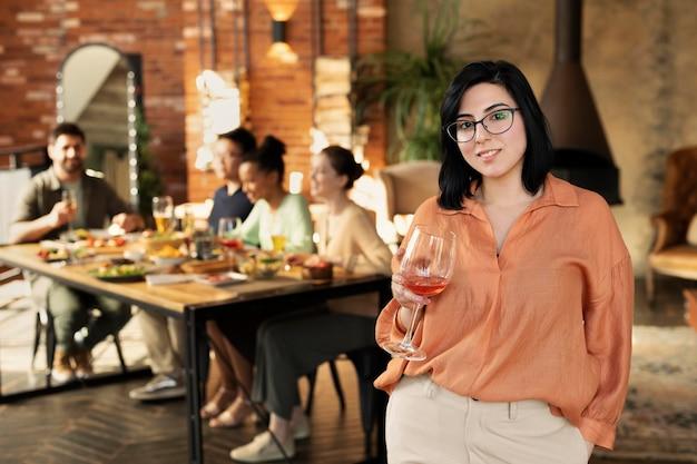 Medium shot woman holding glass