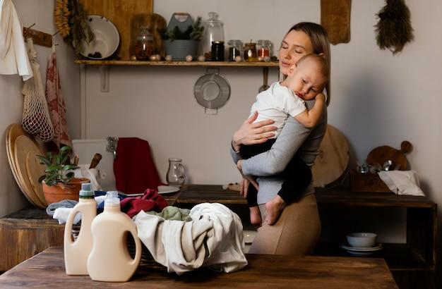 Medium shot woman holding kid