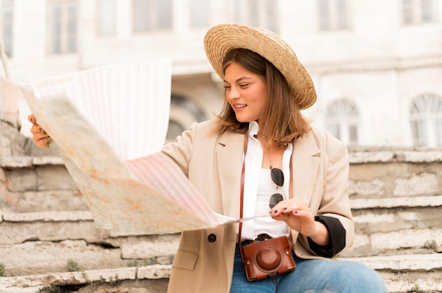 Medium shot woman holding map