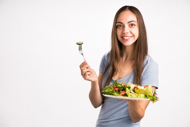 Medium shot of woman holding a salad
