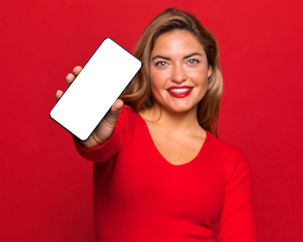 Medium shot woman holding smartphone