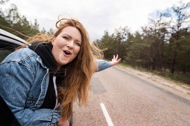 Medium shot woman inside car