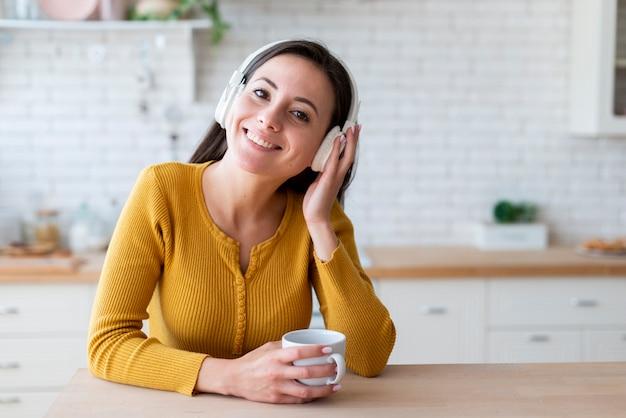 Medium shot of woman listening to music