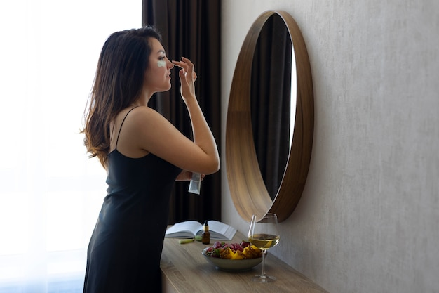 Medium shot woman looking in the mirror