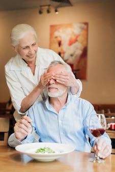 Medium shot woman making husband a surprise