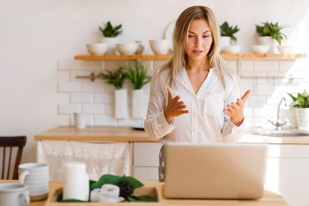 Medium shot woman at online meeting
