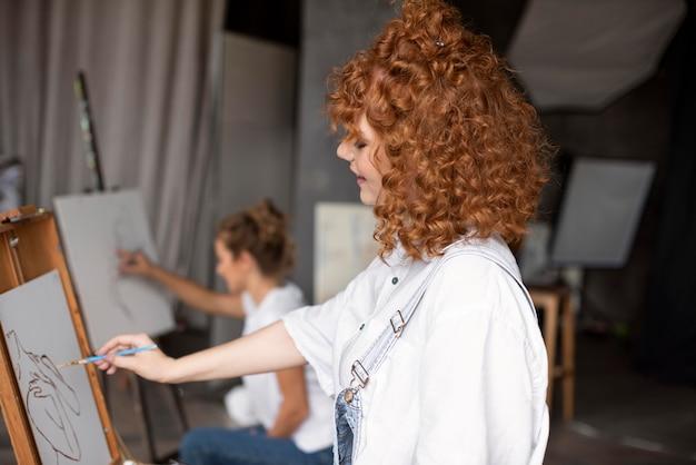 Medium shot woman painting with brush