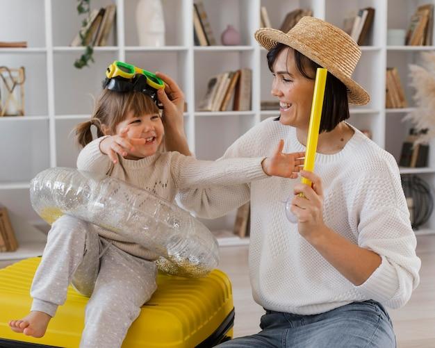 Medium shot woman playing with girl