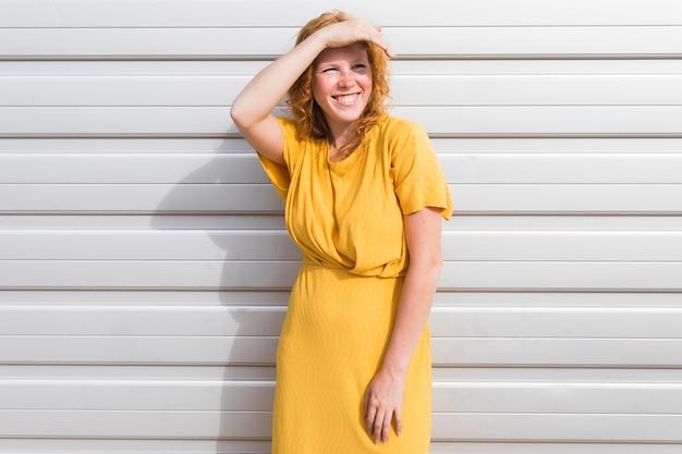 Medium shot woman posing in dress