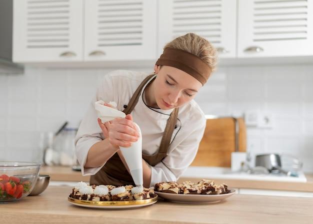Medium shot woman preparing dessert