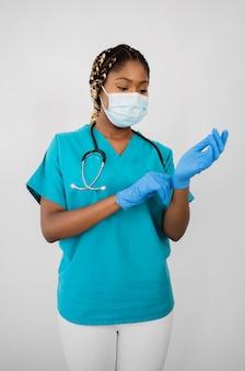 Medium shot woman putting on gloves