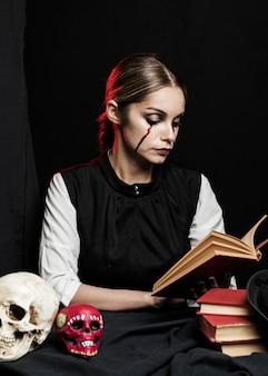 Medium shot of woman reading book