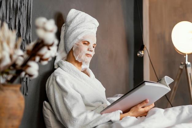 Medium shot woman reading Free Photo