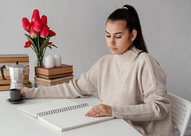Medium shot woman reading