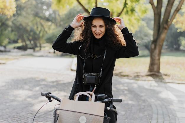 Medium shot woman riding the bicycle