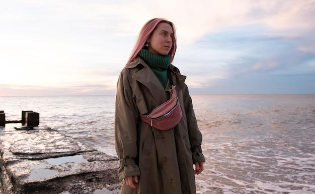 Medium shot woman at seaside