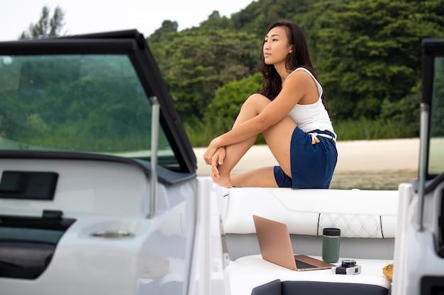 Medium shot woman sitting on boat