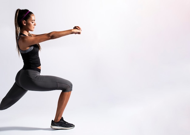 Medium shot woman stretching with copy-space