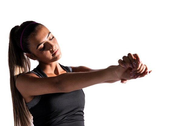 Medium shot woman stretching with white background