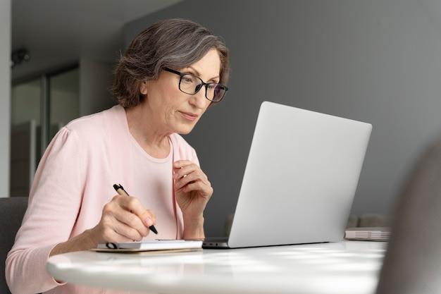 Medium shot woman taking notes