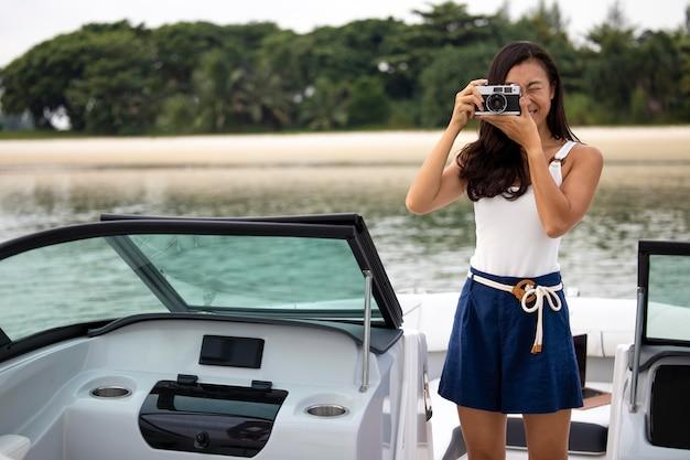 Medium shot woman taking photos on boat