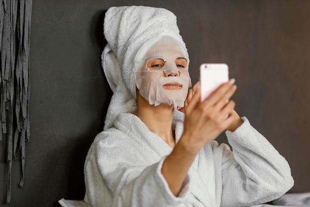 Medium shot woman taking selfie