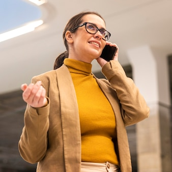 Medium shot woman talking on phone