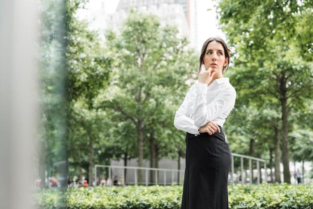 Medium shot woman thinking outdoors