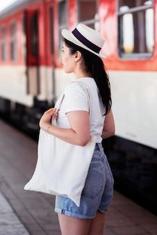 Medium shot woman at train station