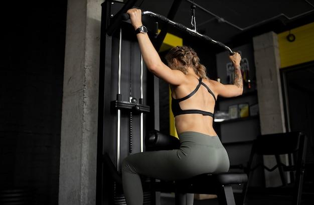 Medium shot woman training gym