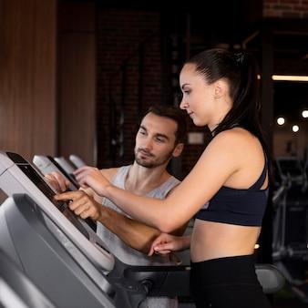 Medium shot woman on treadmill