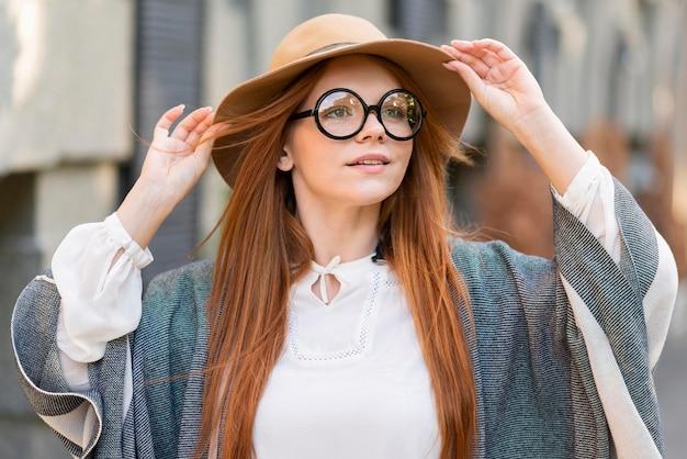 Medium shot woman wearing glasses