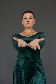 Medium shot woman wearing green dress