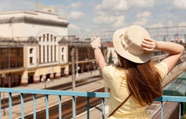 Medium shot woman wearing hat