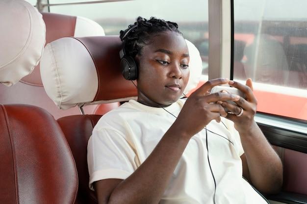 Medium shot woman wearing headphones