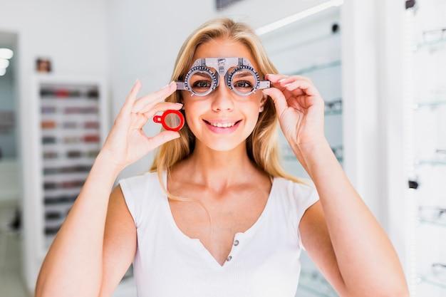 Medium shot of woman wearing trial frames