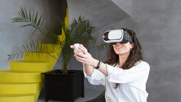 Medium shot of woman wearing a vr set