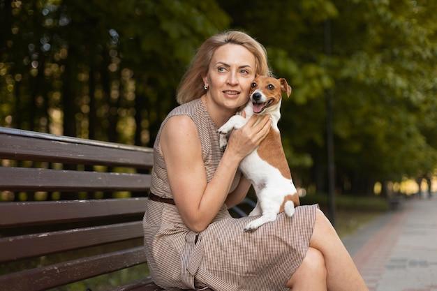 Medium shot woman with adorable dog