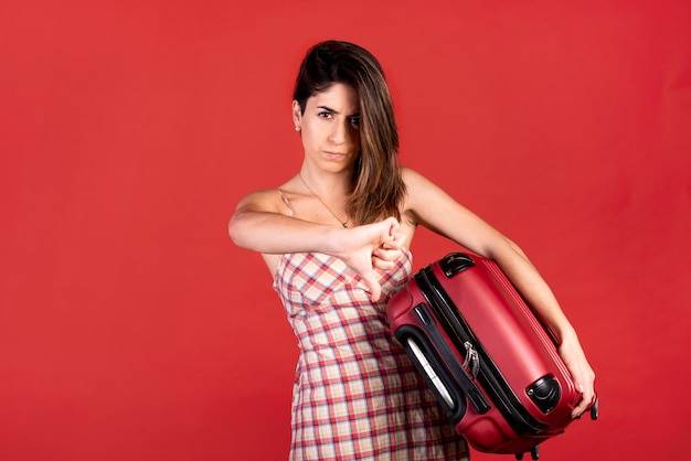 Medium shot woman with baggage