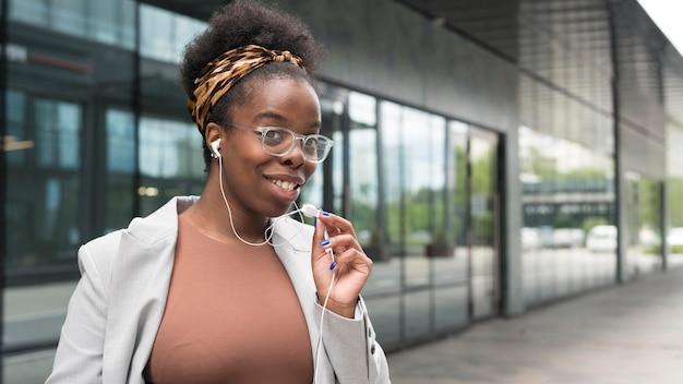 Medium shot woman with earphones