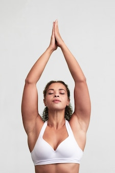 Medium shot woman with her arms up