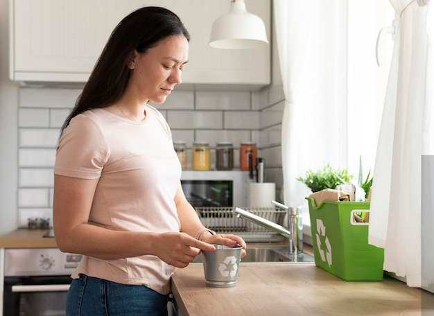 Medium shot woman with kitchen