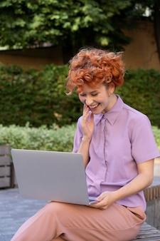 Medium shot woman with laptop