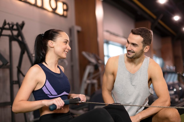 Medium shot woman with personal trainer